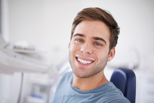Young man smiling after composite filling at Nancy Shiba, DDS.